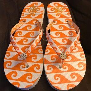 Tory Burch Orange white wave printed flip flops